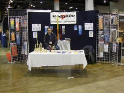 Designer Tim MacLeod in front of the Sunward booth